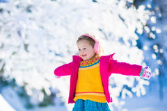 Child in snowy winter park Royalty Free Stock Photo