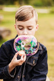 Child and soap bubble Stock Image