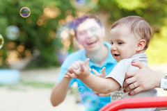 Child with soap bubbles Stock Images
