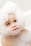 Child in soapsuds stock photos