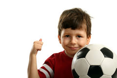 Child with soccer ball shows OK Royalty Free Stock Images