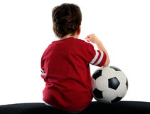 Child with soccer ball sitting back Royalty Free Stock Photo