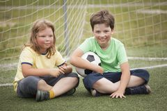 Child soccer football player. Boy with ball on green grass. Child soccer football player. Boy with ball on green grass Stock Image