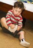 Child with socks Stock Image