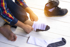 Child with socks in his hand or preparing for travel Stock Photos