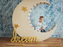 Child in soft and warm pajamas lying Stock Photography