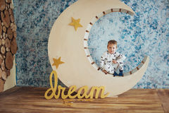 Child in soft and warm pajamas lying Royalty Free Stock Photo
