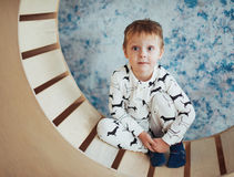 Child in soft and warm pajamas lying Stock Images