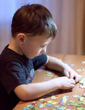 Child Solving a Puzzle - Education Royalty Free Stock Photography