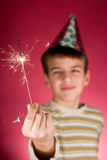 Child and sparklers. Child watching a cool firework, sparklers Stock Image