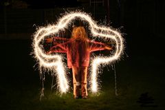 Child sparkles. Child with sparklers Stock Image