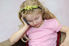 Child speaking by mobile phone Royalty Free Stock Image