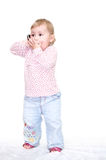 Child speaking by phone. Cut little child speaking by mobile phone. Full-length portrait. Isolated on white. Studio photo Stock Image