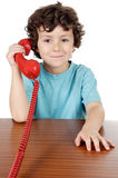 Child speaking on the phone. Child speaking on the telephone a over white background Royalty Free Stock Photo