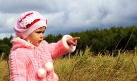 The child specifies a finger Royalty Free Stock Photo