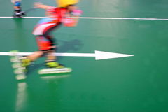 Child speed skating (blurred) Stock Images