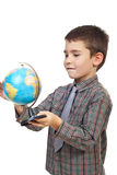 Child spin a globe stock image