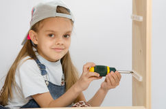 Child spins mounting boxes, collecting cabinet Stock Images