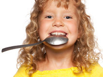 Child with spoon Royalty Free Stock Images