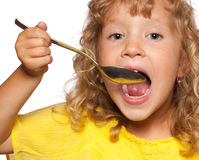 Child with spoon Stock Image