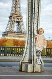 Child in sport style clothes against Eiffel tower in Paris Stock Photos