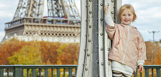 Child in sport style clothes against Eiffel tower in Paris Stock Image