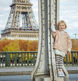 Child in sport style clothes against Eiffel tower in Paris Royalty Free Stock Images