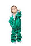 Child in sports suit raised thumb up. Little baby in a big, over-sized, sports suit showing thumb up isolated on white background Royalty Free Stock Photography