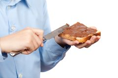 Child spreading peanut butter on bread Stock Photo