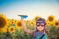 Child in spring field stock image