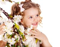 Child with spring flower. Stock Photography