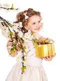 Child with spring flower. Stock Photo