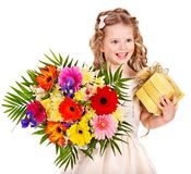 Child with spring flower and gift box. Stock Photos