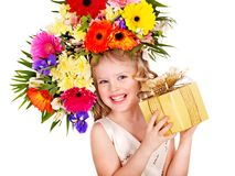 Child with spring flower and gift box. Stock Photography