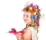 Child in spring hairstyle and butterfly. Stock Photography