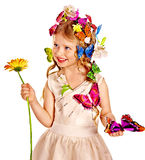 Child in spring hairstyle and butterfly. Stock Photo