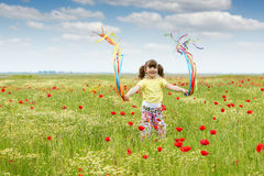 Child on spring meadow Stock Image