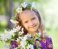 Child at spring park. Girl at spring park. Little girl with branches blossoming apple tree Stock Image