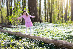 Child in spring park with flowers Royalty Free Stock Image