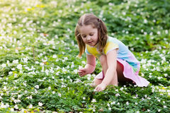 Child in spring park with flowers Royalty Free Stock Images