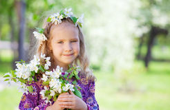 Child at spring park. Girl at spring park. Little girl with branches blossoming apple tree Royalty Free Stock Photos