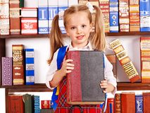 Child with stack book. Stock Image