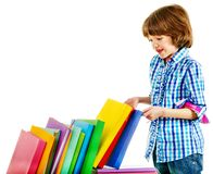 Child with stack of books. Royalty Free Stock Photos