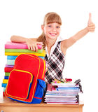 Child with stack of books and showing thumb up. Royalty Free Stock Photo