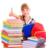 Child with stack of books and showing thumb up. Stock Photo
