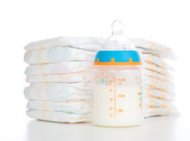 Child stack of diapers and baby feeding bottle with milk Stock Photography