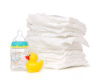 Child stack of diapers baby feeding milk bottle with water Royalty Free Stock Photos