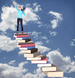 Child on staircase of books Royalty Free Stock Images