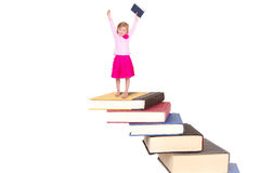 Child on staircase of books Stock Image