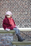 Child on the stairs. A child sitting on the stairs Royalty Free Stock Photos